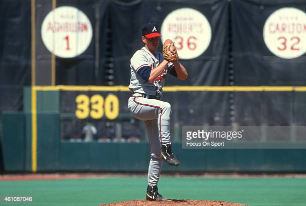 Tom Glavine of the Atlanta Braves pitches against the Philadelphia Phillies during an Major League Baseball game circa 1993 at Veterans Stadium in...