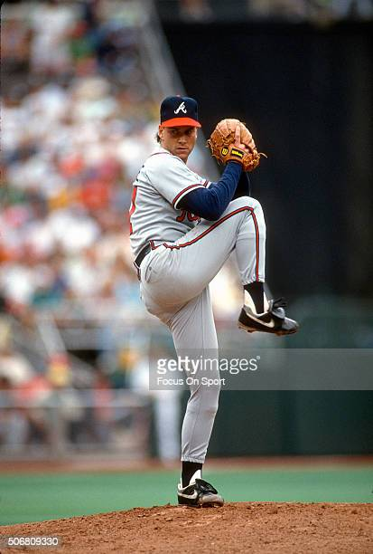 Tom Glavine of the Atlanta Braves pitches against the Philadelphia Phillies during an Major League Baseball game circa 1991 at Veterans Stadium in...