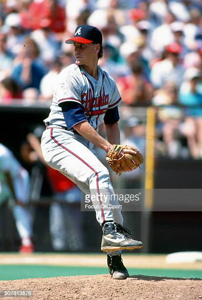 Tom Glavine of the Atlanta Braves pitches against the Philadelphia Phillies during a Major League Baseball game circa 1990 at Veterans Stadium in...