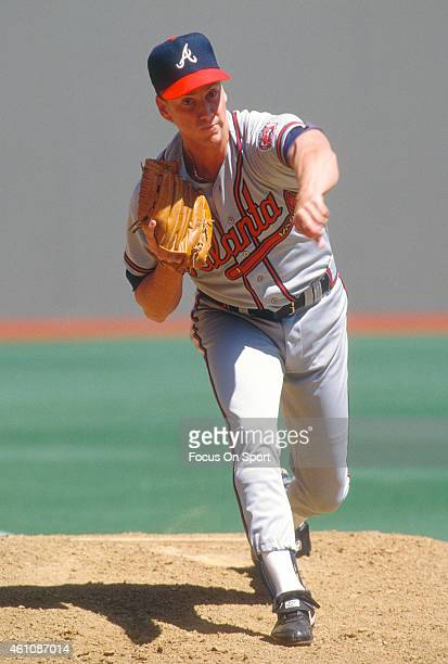 Tom Glavine of the Atlanta Braves pitches against the St Louis Cardinals during an Major League Baseball game circa 1990 at Busch Stadium in St Louis...