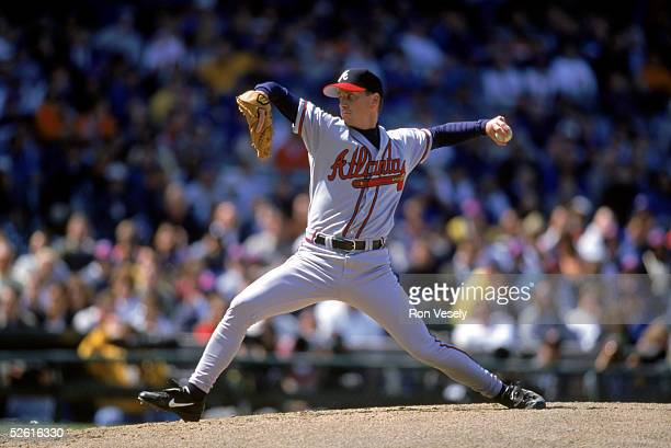 Tom Glavine of the Atlanta Braves pitches during a 1999 season game at Wrigley Field in Chicago Illinois Tom Glavine played for the Atlanta Braves...
