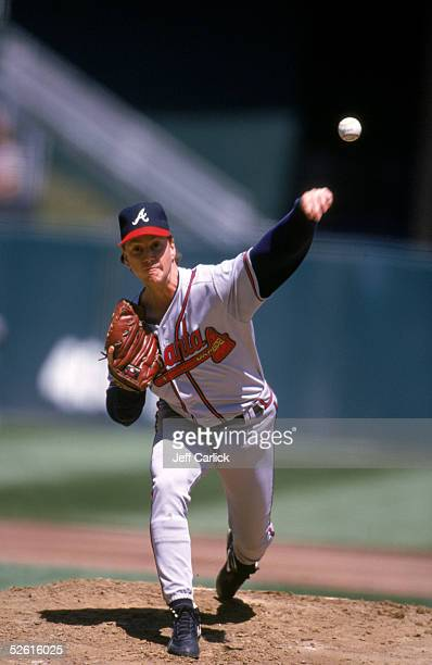 Tom Glavine of the Atlanta Braves pitches during a season game Tom Glavine played for the Atlanta Braves from 19872002