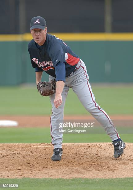 Tom Glavine of the Atlanta Braves pitches during the spring training game against the Detroit Tigers at Joker Marchant Stadium in Lakeland Florida on...