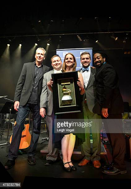 Tom Goldfogle President of the DC Chapter of the Recording Academy presents the Enterprise Award to Bill Stevens Anastacia Rubach Austin Isaac and...