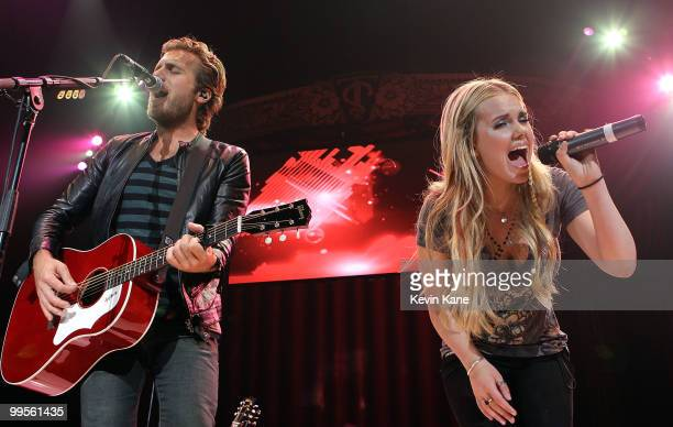 Tom Gossin and Cheyene Kimball of Gloriana perform at the Nassau Veterans Memorial Coliseum on May 14, 2010 in Uniondale, New York.