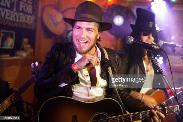 Tom Gossin performs at the TJ Martell Foundation's Battle for the Bones for the Linds Sarcoma Fund at Losers Bar Grill on October 31 2013 in...