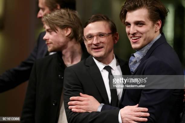 Tom Gramenz Florian Lukas and Jonas Dassler attend the 'The Silent Revolution' premiere during the 68th Berlinale International Film Festival Berlin...