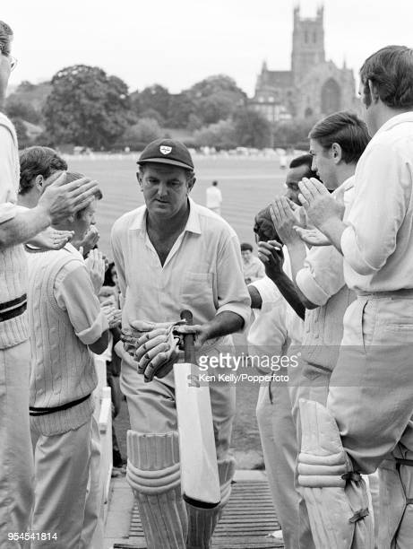 Tom Graveney of Worcestershire is applauded from the field by his teammates at the end of his last batting innings in County Championship cricket...