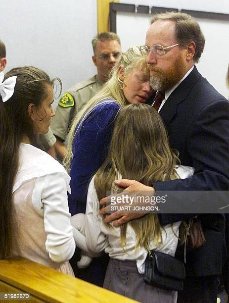 Tom Green holds his grieving wife Hannah and daughter Sierra after the jury found Green guilty on all accounts of bigamy and criminal nonsupport in...