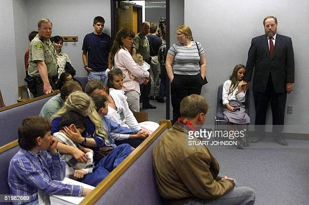 Tom Green stands inside the courtroom and comforts his daughter Sierra, as other family members grieve the jury decision of Tom being guilty on all...