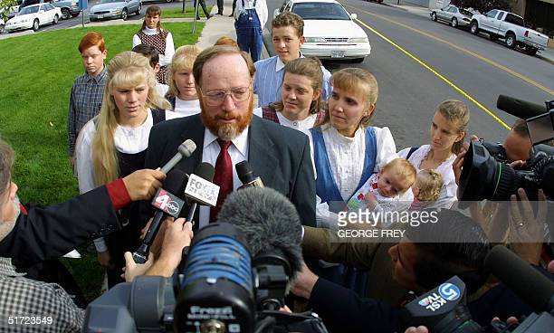 Tom Green talks with reporters outside Fourth District Court with his five wive's Hannah Cari Linda LeeAnn Shirley in Provo UT August 24 2001 Green...