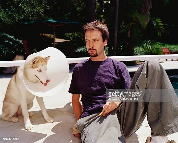 Tom Green with Husky in Buster Collar