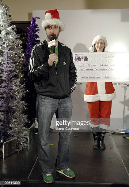 Tom Greene with the Mika, winner of the New York Yahoo Santa Talent Search