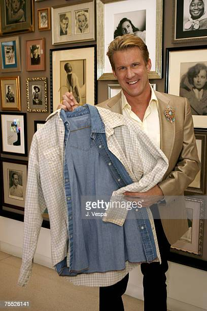 Tom Gregory with auctioned cowboy shirts worn by Heath Ledger and Jake Gyllenhaal in Brokeback Mountain His winning bid was $10110051 Proceeds to...
