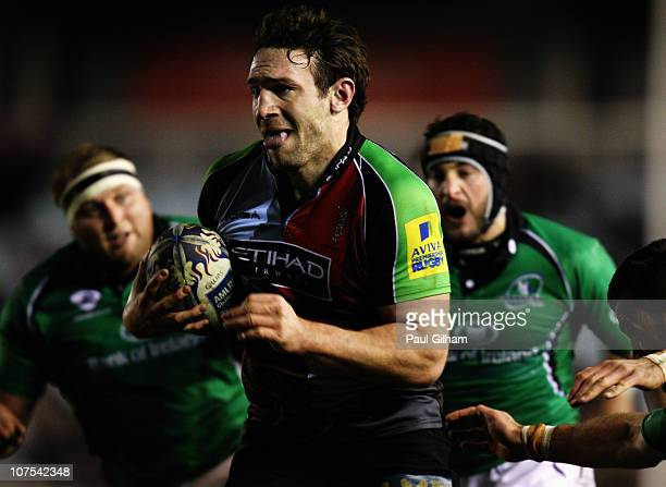 Tom Guest of Harlequins breaks through the Connacht Rugby defence to score the first try for Harlequins during the Amlin Challenge Cup match between...