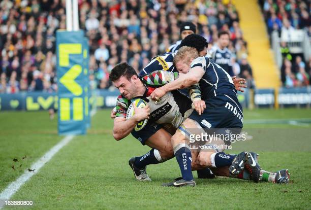 Tom Guest of Harlequins drives on to score his team's second try during the LV= Cup Final between Sale Sharks and Harlequins at Sixways Stadium on...