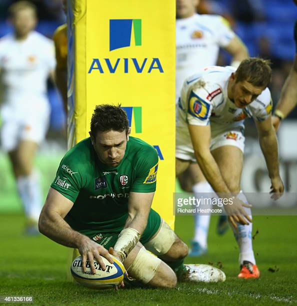 Tom Guest of Irish dives over to score a try during the Aviva Premiership match between London Irish and Exeter Chiefs at Madejski Stadium on January...