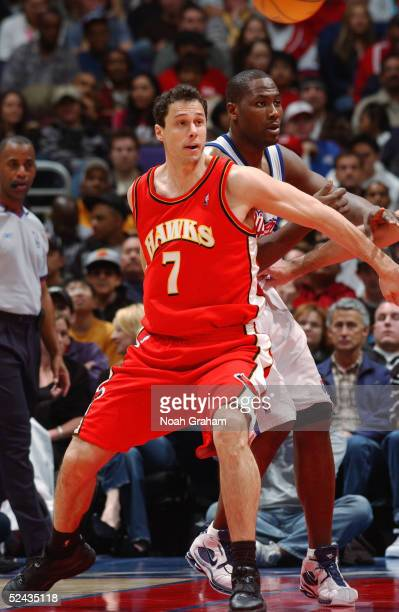 Tom Gugliotta of the Atlanta Hawks posts up against Elton Brand of the Los Angeles Clippers during the game on February 27 2005 at the Staples Center...