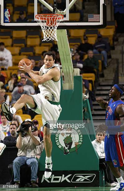 Tom Gugliotta of the Boston Celtics rebounds during a preseason game with the Detroit Pistons on October 27 2004 at FleetCenter in Boston...