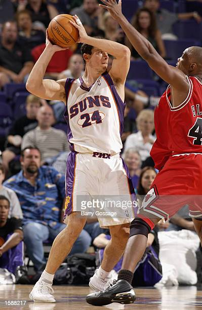 Tom Gugliotta of the Phoenix Suns looks to pass as Corie Blount of the Chicago Bulls defends during the NBA preseason game at the America West Arena...