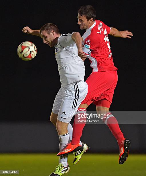 Tom Hagel of FC Strausberg and Mario Eggimann of 1 FC Union Berlin go up for a header during the friendly match between FC Strausberg and 1 FC Union...