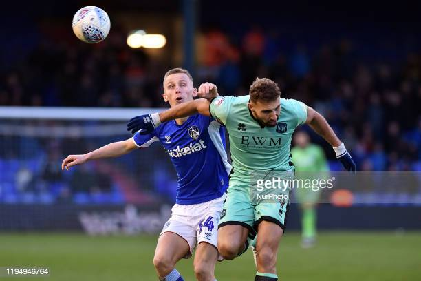 Tom Hamer of Oldham Athletic and Hallam Hope during the Sky Bet League 2 match between Oldham Athletic and Carlisle United at Boundary Park Oldham on...