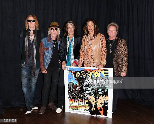Tom Hamilton Brad Whitford Joe Perry Steven Tyler and Joey Kramer of the Rock Band Aerosmith attend the press junket to announce Global Warming the...