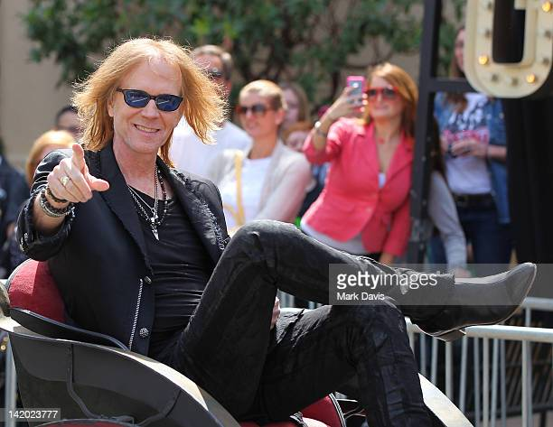Tom Hamilton of Aerosmith arrives at the Aerosmith Press Conference to annouce 'The Global Warming' Tour at The Grove on March 28 2012 in Los Angeles...