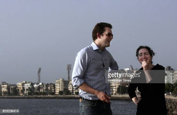 Tom Hamilton producer and researcher for Pangea Day takes a break by Mumbai's seaside with organiser Verjinia Cormie