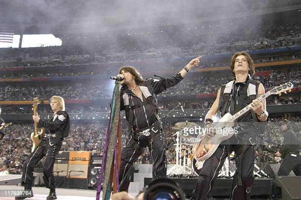 Tom Hamilton Steve Tyler and Joe Perry of Aerosmith perform during the Super Bowl XXXVIII pregame show entitled 'Welcome to Houston The Spirit of...