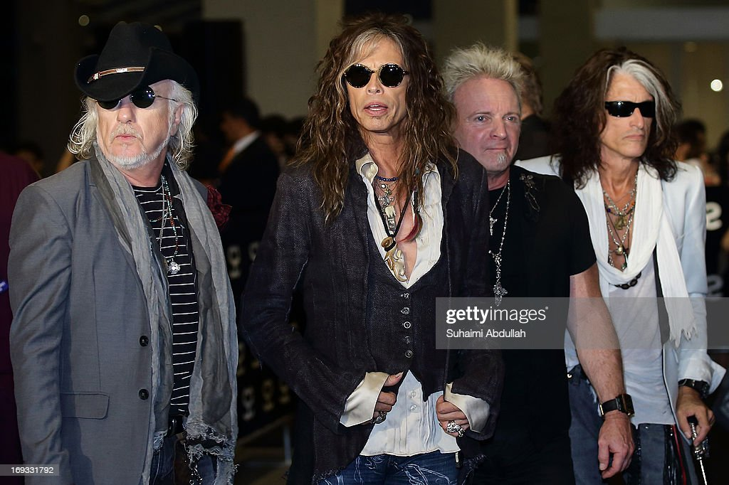Tom Hamilton, Steven Tyler, Joey Kramer and Joe Perry of American rock band Aerosmith walk the red carpet during the Social Star Awards 2013 at Marina Bay Sands on May 23, 2013 in Singapore.
