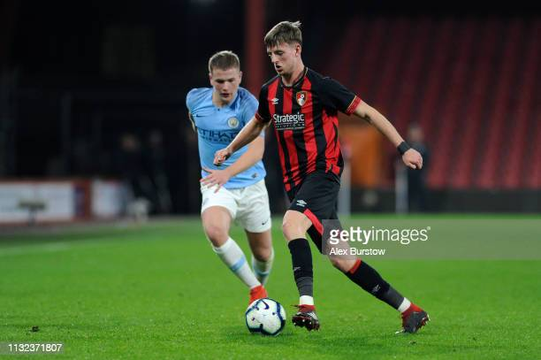 Tom Hanfrey of AFC Bournemouth runs with the ball under pressure from Rowan McDonald of Manchester City during the FA Youth Cup Sixth Round Match...