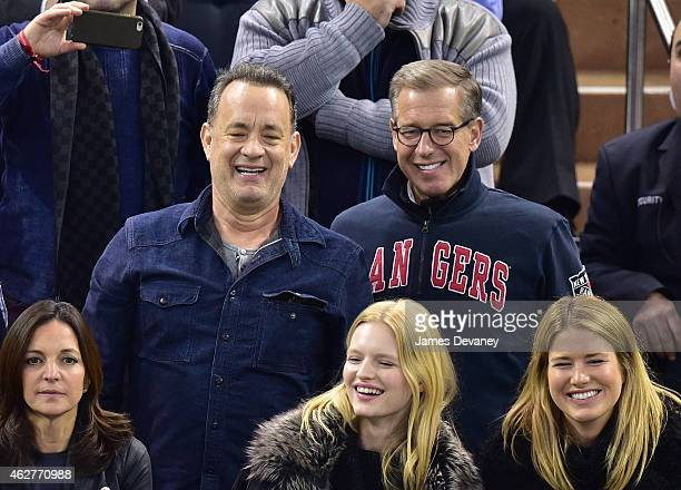 Tom Hanks and Brian Williams attend the Boston Bruins vs New York Rangers game at Madison Square Garden on February 4 2015 in New York City