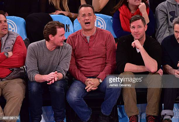 Tom Hanks and Ed Burns attend the Sacramento Kings vs New York Knicks game at Madison Square Garden on March 3 2015 in New York City
