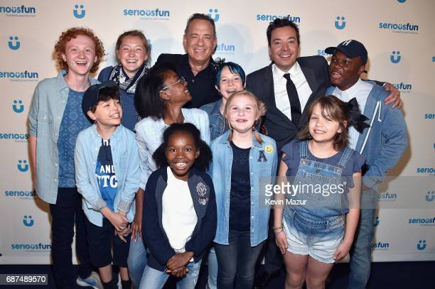 Tom Hanks and Jimmy Fallon pose with SeriousFun Campers at the SeriousFun Children's Network Gala at Pier 60 on May 23 2017 in New York City