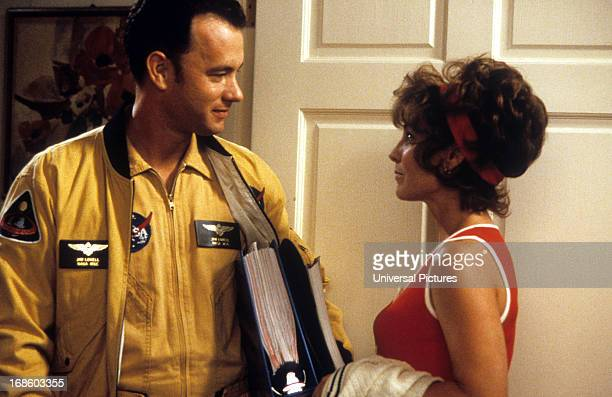 Tom Hanks and Kathleen Quinlan looking at each other at doorway in a scene from the film 'Apollo 13' 1995