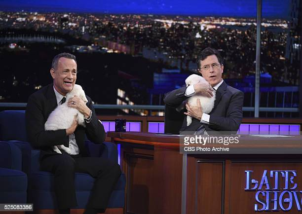 Tom Hanks and Late Show host Stephen Colbert hold adorable puppies during The Late Show with Stephen Colbert on Thursday April 21 2016 in New York
