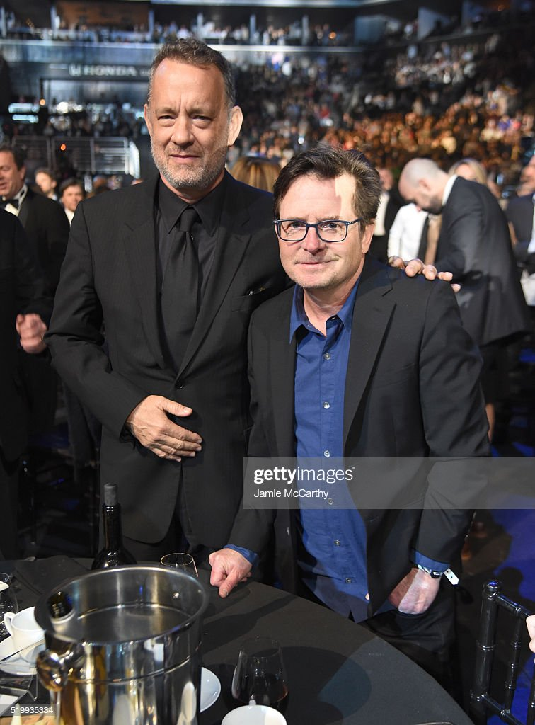 Tom Hanks (L) and Michael J. Fox attend the 31st Annual Rock And Roll Hall Of Fame Induction Ceremony at Barclays Center of Brooklyn on April 8, 2016 in New York City.
