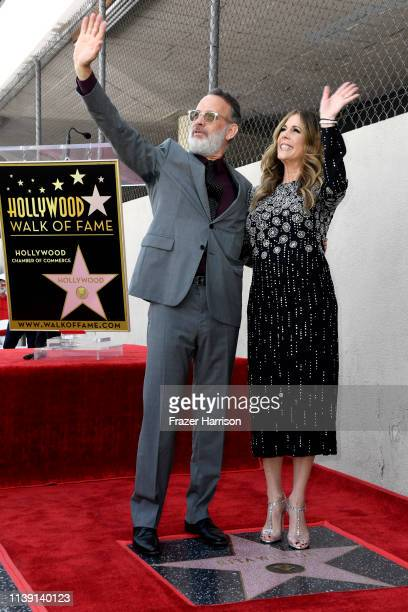 Tom Hanks and Rita Wilson stand next to Wilson's star as she is honored on the Hollywood Walk of Fame on March 29 2019 in Hollywood California