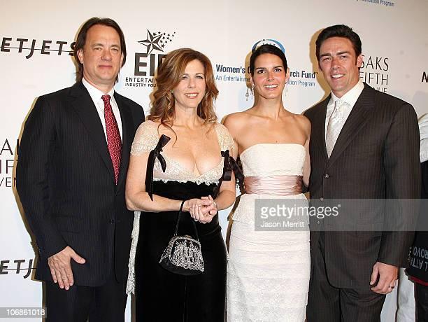 Tom Hanks and Rita Wilson with Angie Harmon and Jason Sehorn