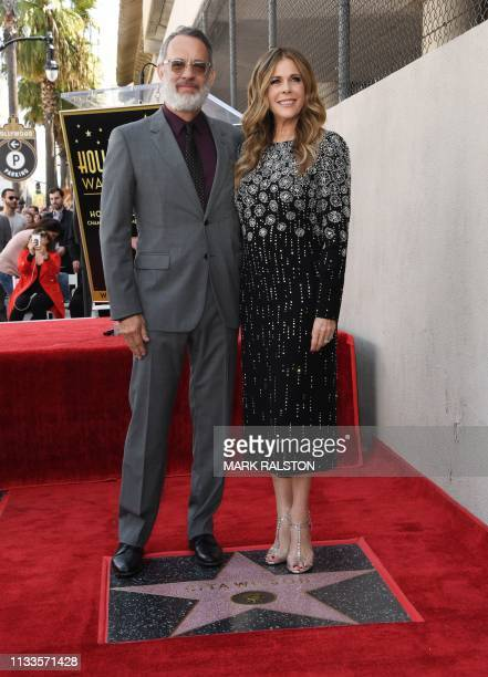 Tom Hanks and wife Rita Wilson stand before her newly unveiled star after she was honored on the Hollywood Walk of Fame in Hollywood California on...