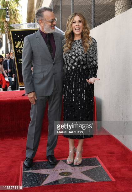 Tom Hanks and wife Rita Wilson stand with her newly unveiled star after she was honored on the Hollywood Walk of Fame in Hollywood California on...