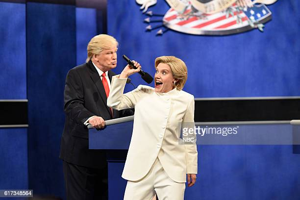 """Tom Hanks"""" Episode 1708 -- Pictured: Alec Baldwin as Republican Presidential Candidate Donald Trump and Kate McKinnon as Democratic Presidential..."""