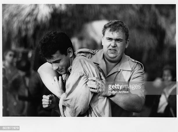 Tom Hanks is grabbed by John Candy in a scene for the TriStar Pictures movie Volunteers circa 1984