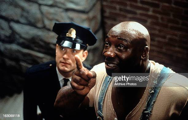 Tom Hanks is guided by Michael Clarke Duncan in a scene from the film 'The Green Mile' 1999