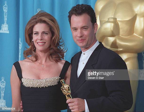 Tom Hanks is joined by his wife, Rita Wilson, at the 1995 Academy Awards ceremony in Los Angeles. Hanks won the Best Actor award for his role in...