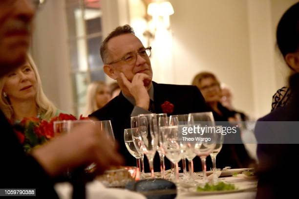 Tom Hanks watches his wife Rita Wilson receive an award at the 2018 American Friends of Blerancourt Dinner on November 9 2018 in New York City