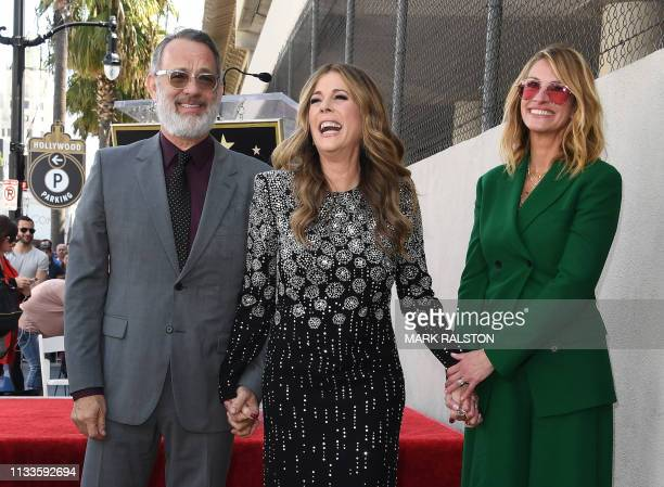 Tom Hanks wife Rita Wilson and Julia Roberts stand on Wilson's newly unveiled star after she was honored on the Hollywood Walk of Fame in Hollywood...
