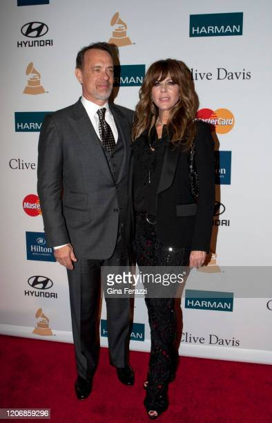 Tom Hanks with wife Rita Wilson on the red carpet before the Clive Davis preGrammy party at the Beverly Hilton