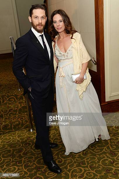 Tom Hardy and Kelly Marcel attend the EE British Academy Film Awards 2014 after party at The Grosvenor House Hotel on February 16 2014 in London...